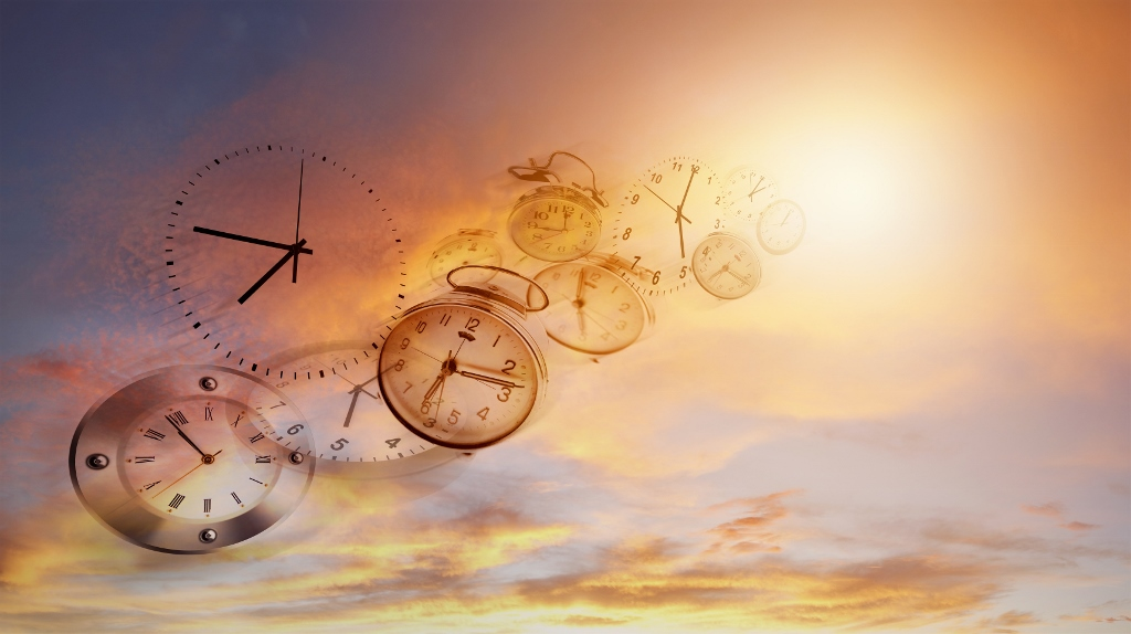 A series of clock faces floating through a bright sky illustrate time flies.