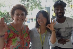 Certified Laughter Yoga Teacher Heather Joy with international students from China and Nigeria attending Central Queensland University