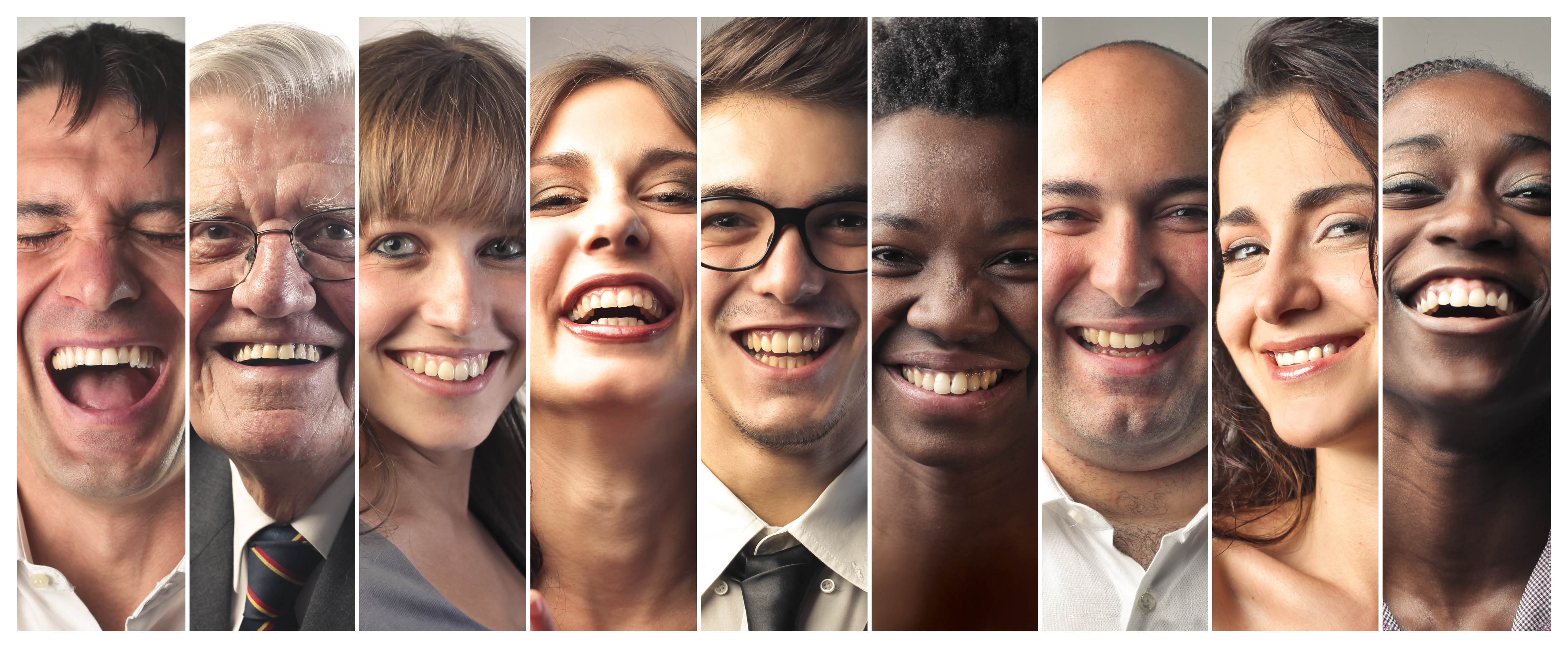 Many men and women of diverse ethnicities and ages smiling and laughing