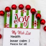 A Christmas wish list decorated with small baubles. The list has three items: health, inner calm and peace for all