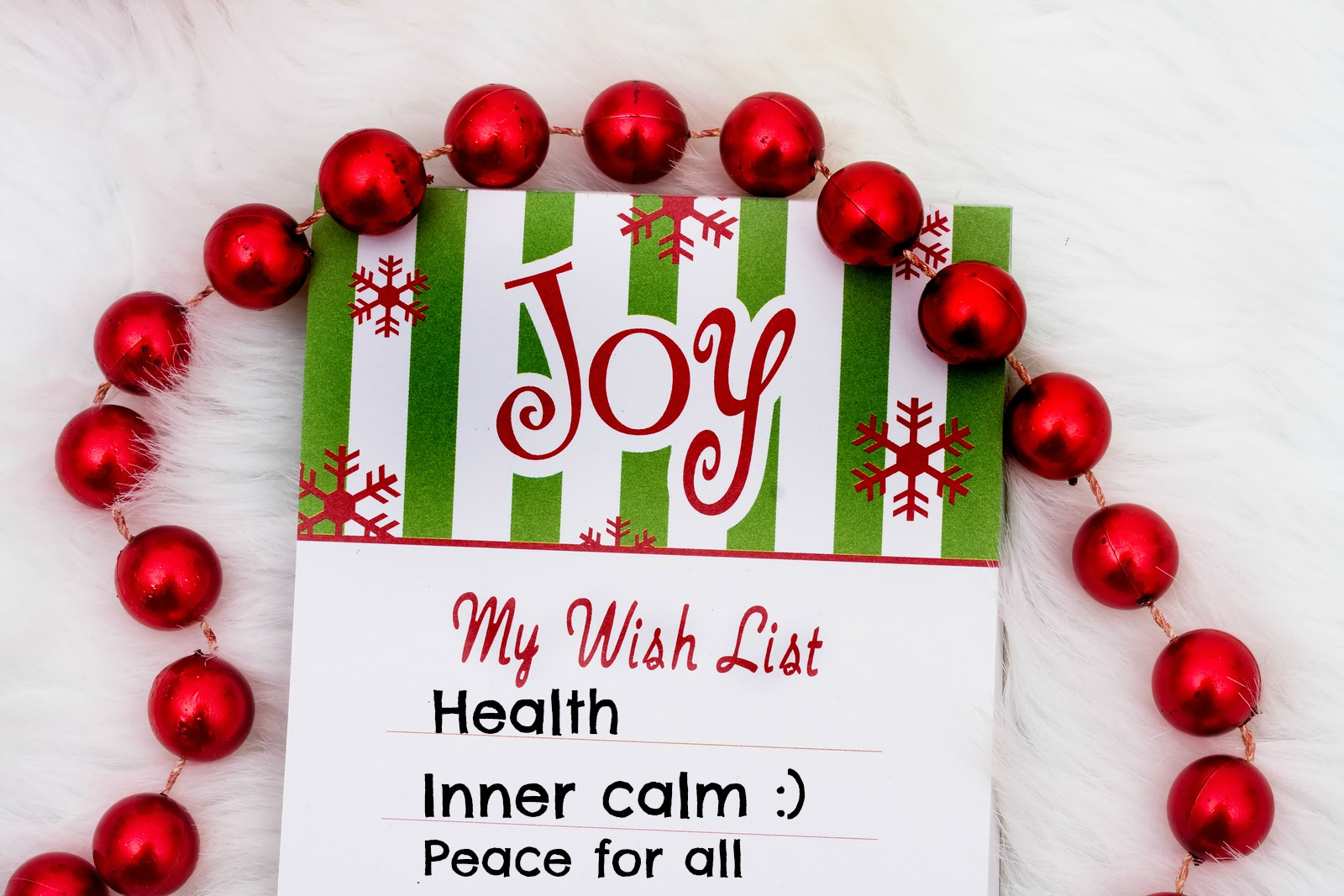A Christmas Wish List Decorated With Small Baubles The Has Three Items Health